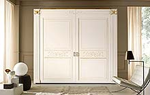 wardrobe with flush doors:glazed antique white finish with ochre decorations and gold details