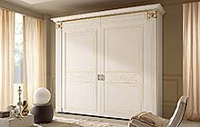 wardrobe with flush doors with top section cornice:glazed antique white finish with  ochre decorations and gold details
