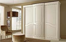 wardrobe with three sliding doors  with central curved hinged door:antique white finish with mother-of-pearl sections