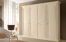 wardrobe with four hinged doors: antique finished and ochre color washes and decorations