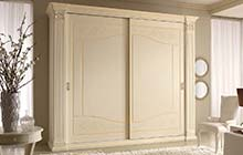 wardrobe with two sliding doors: glazed honey finish with ochre decorations and color wash