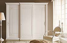 wardrobe with central sliding doors, hinged side doors with a light Florentine waxy finish with a dusty blue color wash