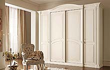 wardrobe with central sliding doors, hinged side doors: glazed antique white finish  and ochre decorations