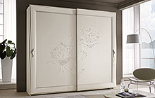 sliding 2- and 3-door wardrobe Antique white finish with stucco decoration and silver trim