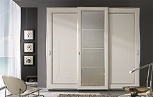 sliding 3-door wardrobe Antique white finish with decoration and central glass panel